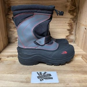 The North Face waterproof boots for kids black red
